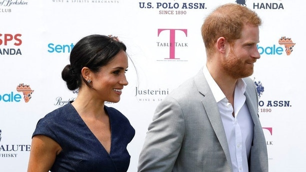 Meghan, Duchess of Sussex and Britain's Prince Harry leave after posing for a photo upon their arrival at the Royal County of Berkshire Polo Club in Windsor, England, Thursday, July 26, 2018. Britain's Prince Harry is set to play in the Sentebale ISPS Handa Polo Cup.(AP Photo/Matt Dunham)