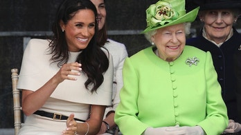Britain's Queen Elizabeth II and Meghan, the Duchess of Sussex, left, attend the opening of the new Mersey Gateway Bridge, in Widnes, north west England, Thursday June 14, 2018. (Danny Lawson/PA via AP)