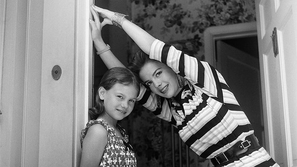 LOS ANGELES,CA - JUNE 18,1955: Actress Natalie Wood and her sister Lana Wood pose for a portrait at home in Los Angeles,CA. (Photo by Earl Leaf/Michael Ochs Archives/Getty Images)