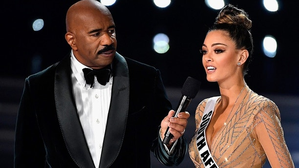 LAS VEGAS, NV - NOVEMBER 26: Television personality and host Steve Harvey (L) speaks to Miss South Africa 2017 Demi-Leigh Nel-Peters during the interview portion of2017 Miss Universe Pageant at The Axis at Planet Hollywood Resort & Casino on November 26, 2017 in Las Vegas, Nevada.  (Photo by Frazer Harrison/Getty Images)