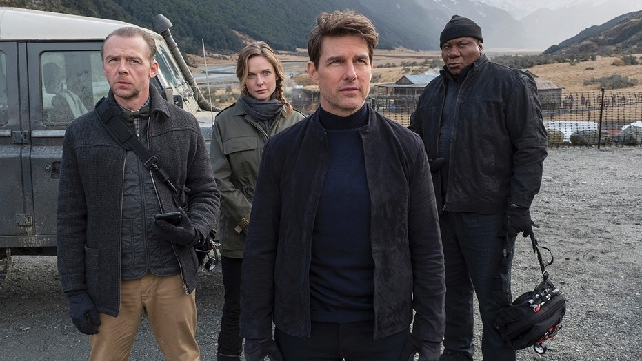 """This image released by Paramount Pictures shows, from left, Simon Pegg, Rebecca Ferguson, Tom Cruise and Ving Rhames in a scene from """"Mission: Impossible - Fallout."""" (David James/Paramount Pictures and Skydance via AP)"""