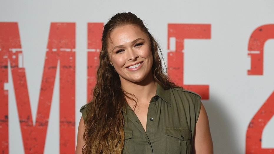 "Cast member Ronda Rousey attends a ""Mile 22"" photo call at the Four Seasons Hotel on Saturday, July 28, 2014 in Los Angeles. (Photo by Jordan Strauss/Invision/AP)"
