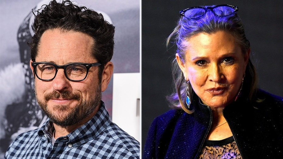 'Star Wars: Episode IX' director J.J. Abrams shared the first photo from the movie set, and paid tribute to the late Carrie Fisher on Twitter Wednesday.