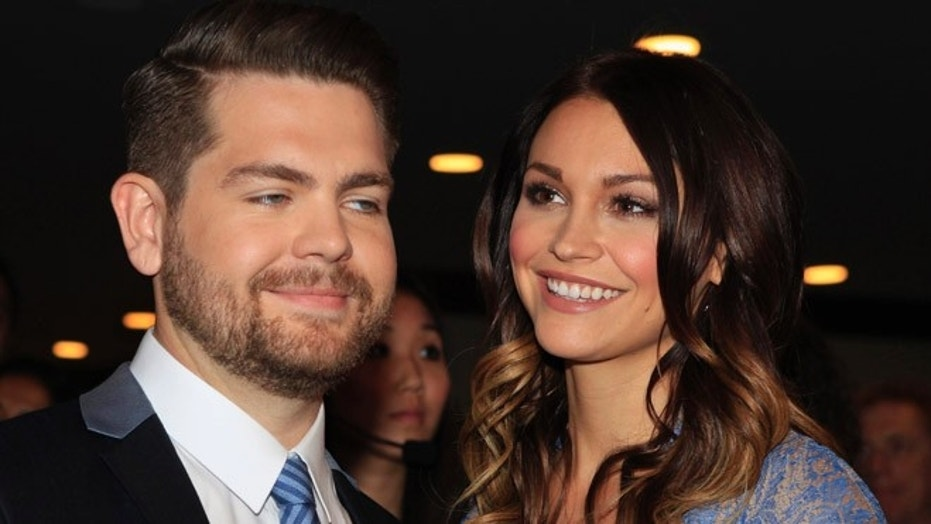 Jack Osbourne and wife Lisa Stelly pose as they arrive at the 20th annual Race to Erase MS benefit gala in Los Angeles, California May 3, 2013. The pair split up in May.