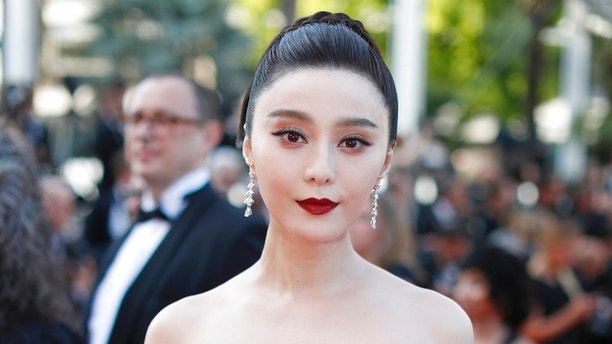 FILE - In this May 24, 2017, file photo, Fan Bingbing poses for photographers as she arrives for the screening of the film The Beguiled at the 70th international film festival, Cannes, southern France. Chinese actress Fan has disappeared from social media amid rumors she is the target of a tax evasion investigation and that she, her brother and boyfriend have been barred from leaving China. (AP Photo/Thibault Camus, File)