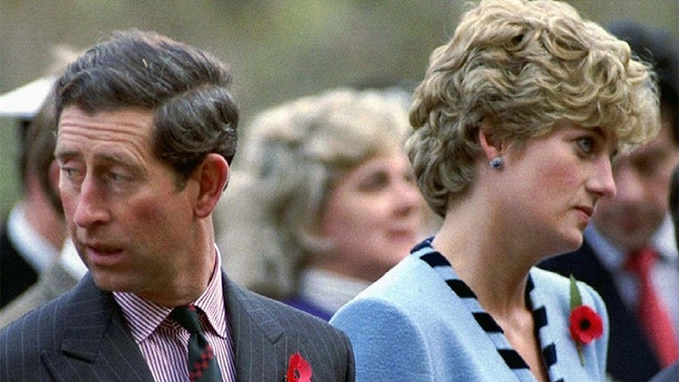 NOV92 FILE PHOTO - Princess Diana and Prince Charles look in different directions during a Korean War commemorative service in November 1992. Princess Diana, who was divorced from Charles in 1996, and her millionaire companion Dodi Al Fayed were killed early Sunday when their car crashed while reportedly being chased through Paris by photographers on motorcycles.FRANCE DIANA - RP1DRIDWLCAA