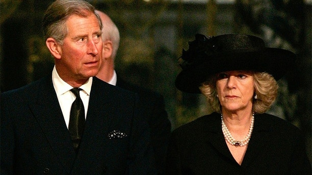 Prince Charles and Camilla Parker-Bowles attend a service in memory of Pope John Paul II at London's Westminster Cathedral.  Britain's Prince Charles (L) and Camilla Parker-Bowles attend a service in memory of Pope John Paul II at London's Westminster Cathedral April 4, 2005. Pope John Paul will be buried in St. Peter's Basilica on April 8, Catholic cardinals decided on Monday as they began to plan the Church's future after the death of the man who led it for a quarter century. Prince Charles has postponed his marriage to long-time lover Camilla Parker Bowles from Friday to Saturday so that he can attend the funeral of Pope John Paul in Rome. REUTERS/Kieran Doherty - RP6DRMSAJJAB