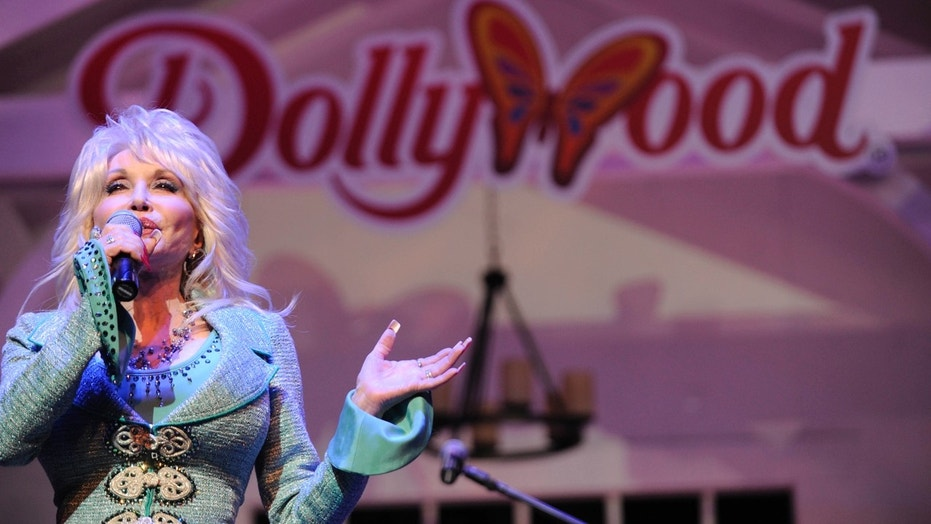 FILE - In this Aug. 21, 2013, file photo, Dolly Parton speaks during a news conference to announce plans to expand her Dollywood properties in Pigeon Forge, Tenn. Parton's Dollywood amusement park has announced a $37 million expansion with rides, a restaurant and live entertainment. (AP Photo/Amy Smotherman Burgess, Knoxville News Sentinel, File)