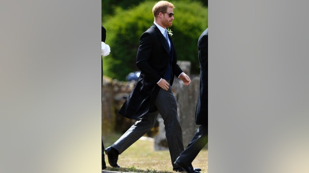 Britain's Prince Harry arrives to attend the wedding of Charlie van Straubenzee and Daisy Jenks at St Mary the Virgin Church in Frensham, England, Saturday, Aug. 4, 2018. (Joe Giddens/PA via AP)