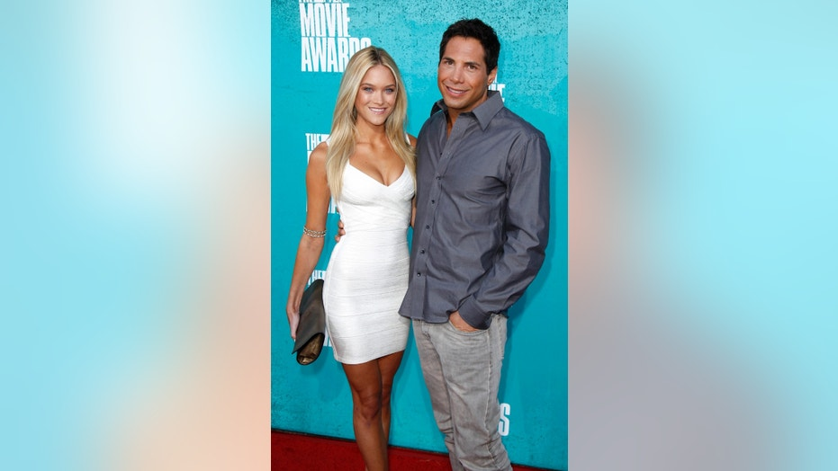 """""""Girls Gone Wild"""" founder Joe Francis and Abbey Wilson arrive at the 2012 MTV Movie Awards in Los Angeles, June 3, 2012."""