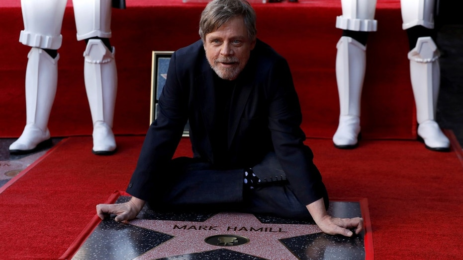 Actor Mark Hamill poses on his star after it was unveiled on the Hollywood Walk of Fame in Los Angeles, California, U.S., March 8, 2018. REUTERS/Mario Anzuoni TPX IMAGES OF THE DAY - RC17C966C3E0