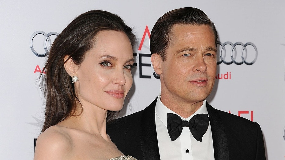 HOLLYWOOD CA- NOVEMBER 05 Angelina Jolie and Brad Pitt attend the premiere of