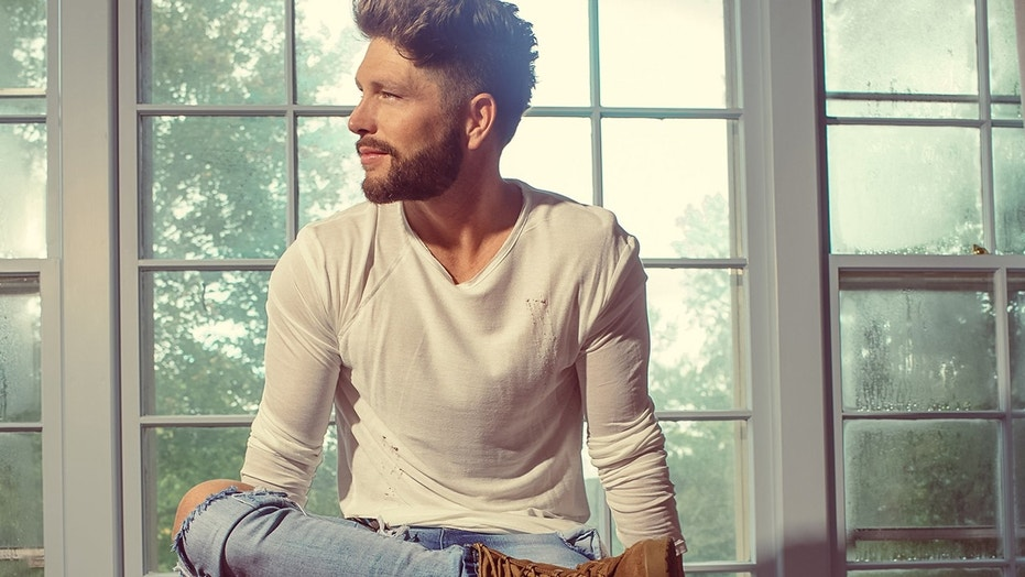 """Country singer Chris Lane recently released his album """"Laps Around the Sun."""""""