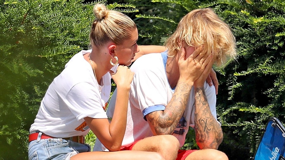 Justin Bieber was photographed looking upset and crying during a bike ride in New York City with his fiancé Hailey Baldwin on Tuesday.