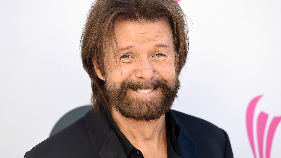 In this Sunday, April 2, 2017, file photo, Ronnie Dunn, of Brooks & Dunn, arrives at the 52nd annual Academy of Country Music Awards at the T-Mobile Arena in Las Vegas. Dunn and singer-songwriter K.T. Oslin will join the Nashville Songwriters Hall of Fame this year, the organization announced Tuesday, Aug. 7, 2018.