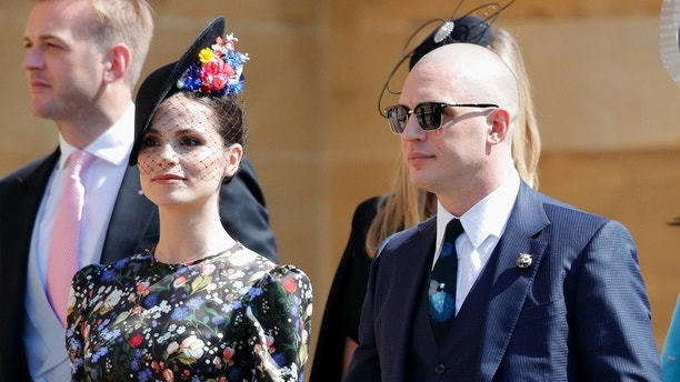 WINDSOR, UNITED KINGDOM - MAY 19: (EMBARGOED FOR PUBLICATION IN UK NEWSPAPERS UNTIL 24 HOURS AFTER CREATE DATE AND TIME) Charlotte Riley and Tom Hardy attend the wedding of Prince Harry to Ms Meghan Markle at St George's Chapel, Windsor Castle on May 19, 2018 in Windsor, England. Prince Henry Charles Albert David of Wales marries Ms. Meghan Markle in a service at St George's Chapel inside the grounds of Windsor Castle. Among the guests were 2200 members of the public, the royal family and Ms. Markle's Mother Doria Ragland. (Photo by Max Mumby/Indigo/Getty Images)