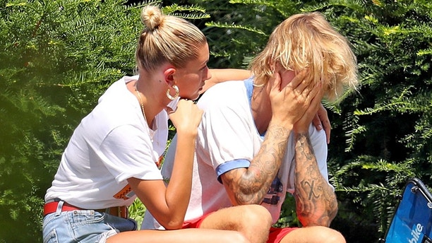 EXCLUSIVE: Justin Bieber seemed visibly upset today as he and fiance, Hailey Baldwin rode Citibikes up the West Side of Manhattan. Hailey did her best to comfort Justin, and at one point their heads were touch for so long that it seemed as if the newly engaged couple might have been praying. Whatever it was, it seems to have worked because the pair eventually git back on their bikes and rode away with smiles on their faces. 07 Aug 2018 Pictured: Justin Bieber, Hailey Baldwin. Photo credit: MEGA TheMegaAgency.com +1 888 505 6342 (Mega Agency TagID: MEGA260623_020.jpg) [Photo via Mega Agency]