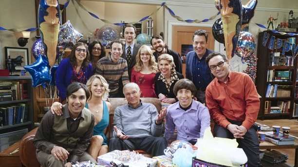 """The Celebration Experimentation"" -- After more than nine years together, the gang finally celebrates Sheldon's birthday, surprising him with a special guest, on the 200th episode of THE BIG BANG THEORY, Thursday, Feb. 25 (8:00-8:31 PM, ET/PT) on the CBS Television Network. Seated left to right: Kunal Nayyar, Kaley Cuoco, Adam West, Simon Helberg and Johnny Galecki Standing left to right: Mayim Bialik, Sara Gilbert, Kevin Sussman, Jim Parsons, Melissa Rauch, Wil Wheaton, Christine Baranski and John Ross Bowie Photo: Monty Brinton/CBS ©2016 CBS Broadcasting, Inc. All Rights Reserved"