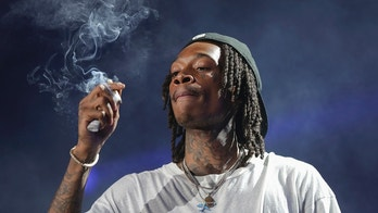 Rapper Wiz Khalifa performs on stage during the Dazed and Blazed Summer 2018 Tour at Jiffy Lube Live on Thursday, Aug. 9, 2018, in Bristow, Va. (Photo by Brent N. Clarke/Invision/AP)