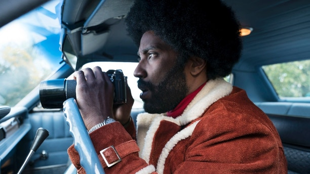 """This image released by Focus Features shows John David Washington in a scene from """"BlacKkKlansman."""" (David Lee/Focus Features via AP)"""
