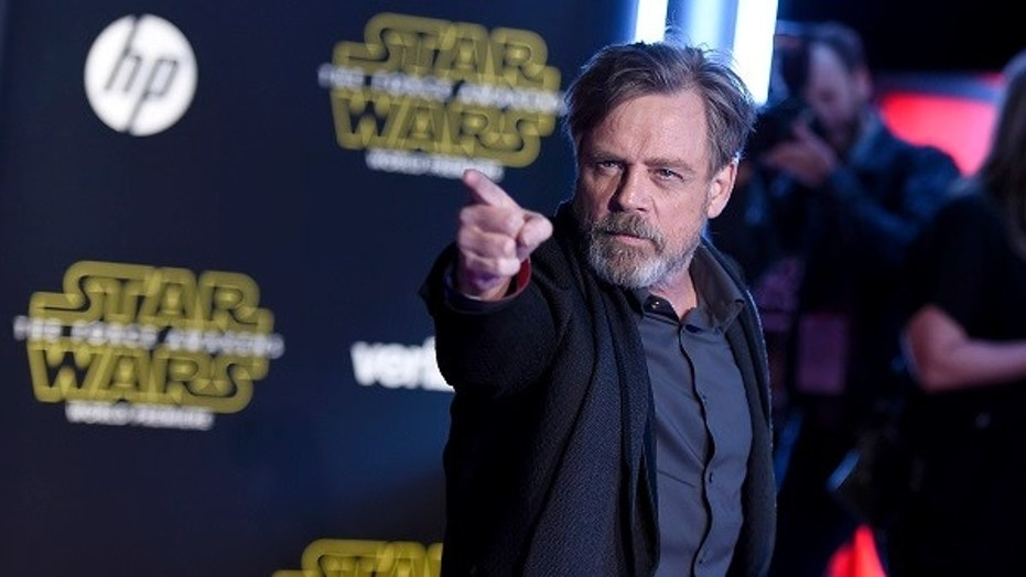 """FILE - In this Dec. 14, 2015, file photo, Mark Hamill arrives at the world premiere of """"Star Wars: The Force Awakens"""" at the TCL Chinese Theatre in Los Angeles. Hamill is featured in the trailer released Oct. 9, 2017, for the follow-up to """"The Force Awakens."""" (Photo by Jordan Strauss/Invision/AP, File)"""
