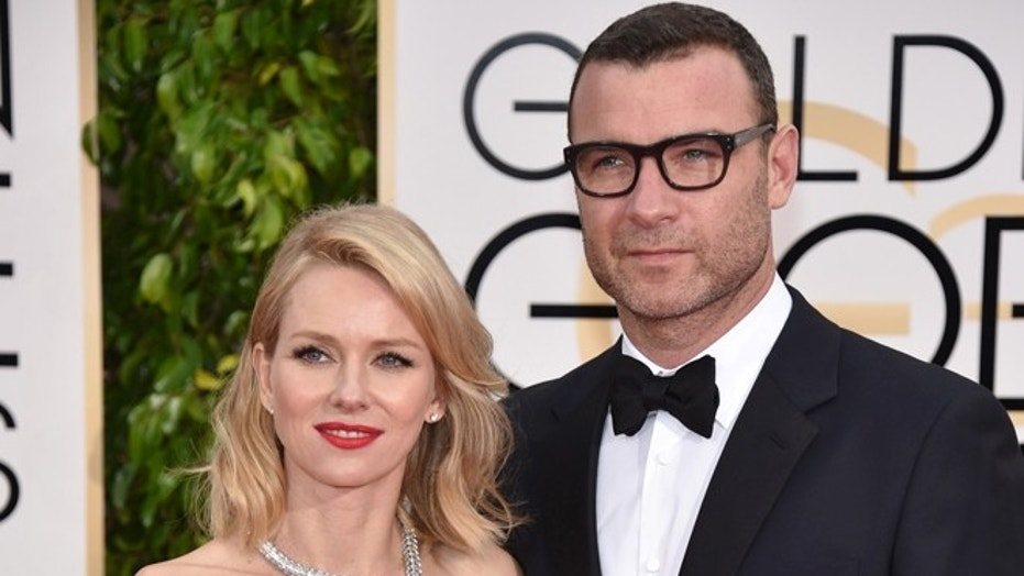 In this file photo from January 11, 2015, Liev Schreiber, right, and Naomi Watts attend the 72nd annual Golden Globe Awards in Beverly Hills, California.