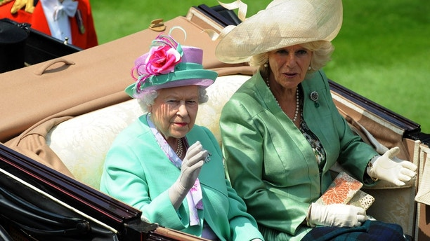Horse Racing - Royal Ascot - Ascot Racecourse - 19/6/13 HRH Queen Elizabeth II (L) and Camilla, Duchess of Cornwall arrive for the second day of Royal Ascot Mandatory Credit: Action Images / Henry Browne Livepic - MT1ACI10985964