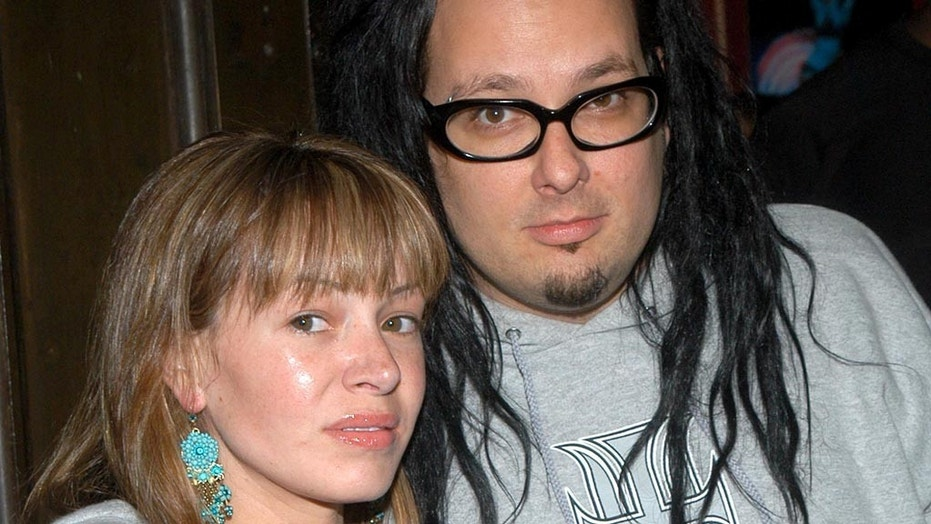 Deven Davis, left, wife of Korn lead singer, Jonathan Davis, has died, Fox News can confirm. She was 39.