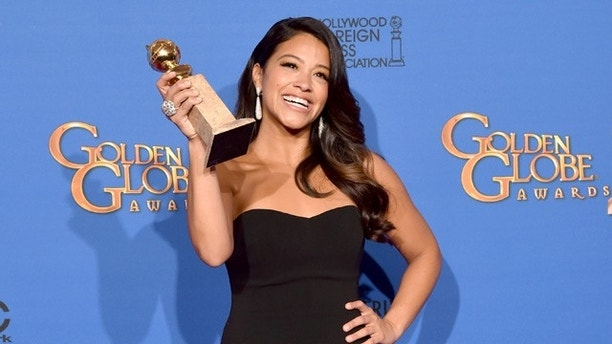 BEVERLY HILLS, CA - JANUARY 11:  Actress Gina Rodriguez, winner of Best Actress in a TV Series, Musical or Comedy for 'Jane the Virgin,' poses in the press room during the 72nd Annual Golden Globe Awards at The Beverly Hilton Hotel on January 11, 2015 in Beverly Hills, California.  (Photo by Kevin Winter/Getty Images)
