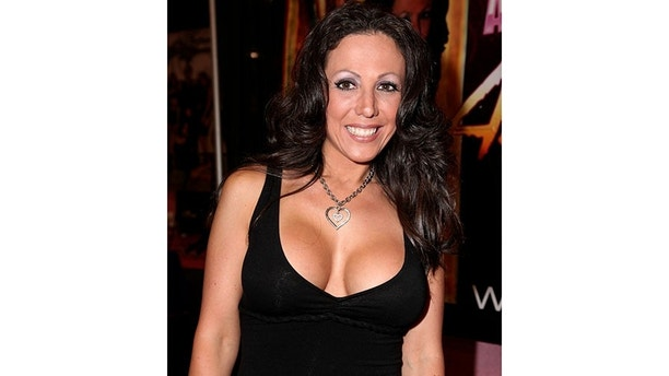"Adult film actress Amy Fisher at the eXXXotica 2009 Miami Beach convention. Amy Fisher is better known as the ""Long Island Lolita"" for serving 7 years in prison after shooting Mary Jo Buttafuoco, the wife of her lover Joey Buttafuoco.