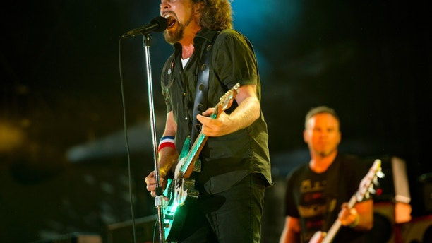 "FILE - In this Sept. 2, 2012, file photo, Pearl Jam performs at the ""Made In America"" music festival in Philadelphia. The Seattle-based rockers and the late rapper Tupac Shakur lead a class of Rock and Roll Hall of Fame inductees that also include folkie Joan Baez and 1970s favorites Journey, Yes and Electric Light Orchestra.  The hall's 32nd annual induction ceremony will take place on April 7, 2016, at Barclays Center in Brooklyn, N.Y.  (Photo by Drew Gurian/Invision/AP, File)"