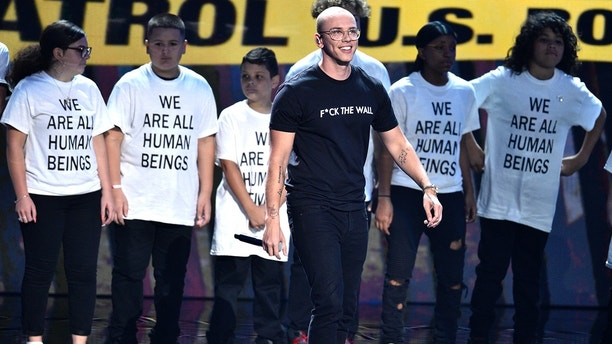 """Logic performs """"One Day"""" onstage at the MTV Video Music Awards at Radio City Music Hall on Monday, Aug. 20, 2018, in New York."""