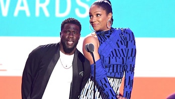 NEW YORK, NY - AUGUST 20: Kevin Hart (L) and Tiffany Haddish speak onstage during the 2018 MTV Video Music Awards at Radio City Music Hall on August 20, 2018 in New York City.  (Photo by Noam Galai/WireImage)