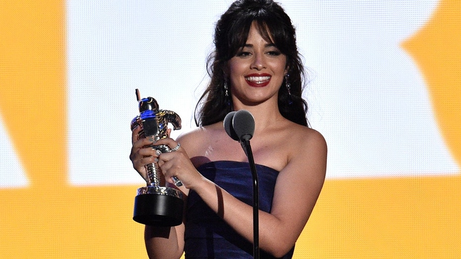 Camila Cabello accepts the award for artist of the year at the MTV Video Music Awards at Radio City Music Hall on Monday, Aug. 20, 2018, in New York.