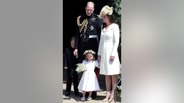Britain's Prince William and Kate, Duchess of Cambridge with Prince George and Princess Charlotte leave after the wedding ceremony of Prince Harry and Meghan Markle at St. George's Chapel in Windsor Castle in Windsor, near London, England, Saturday, May 19, 2018. (Andrew Matthews/pool photo via AP)