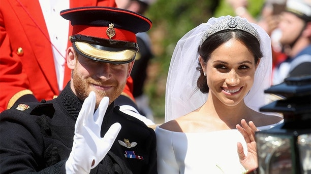 Prince Harry, Duke of Sussex and Meghan, Duchess of Sussex leave Windsor Castle in the Ascot Landau carriage during a procession after getting married at St Georges Chapel on May 19, 2018 in Windsor, England. Prince Henry Charles Albert David of Wales marries Ms. Meghan Markle in a service at St George's Chapel inside the grounds of Windsor Castle. Among the guests were 2200 members of the public, the royal family and Ms. Markle's Mother Doria Ragland.  Chris Jackson/Pool via REUTERS - RC1D2E321900