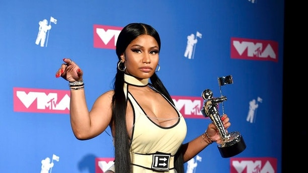 "Nicki Minaj poses in the press room with her award for best hip-hop video for ""Chun-Li"" at the MTV Video Music Awards at Radio City Music Hall on Monday, Aug. 20, 2018, in New York. (Photo by Evan Agostini/Invision/AP)"