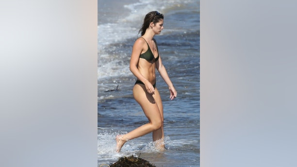 Wednesday, August 22, 2018 - Playboy model Shauna Sexton, 22, is stiking in a red coverall as she hits the beach in Malibu while beau Ben Affleck, 46, meets with ex Jennifer Garner at his home in the Pacific Palisades. - 