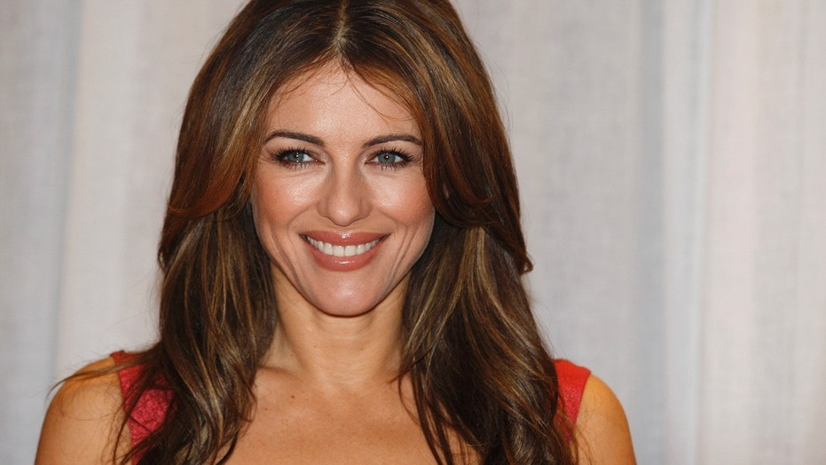 Elizabeth Hurley shared a flirtatious video of her swimming topless while vacationing in Greece.