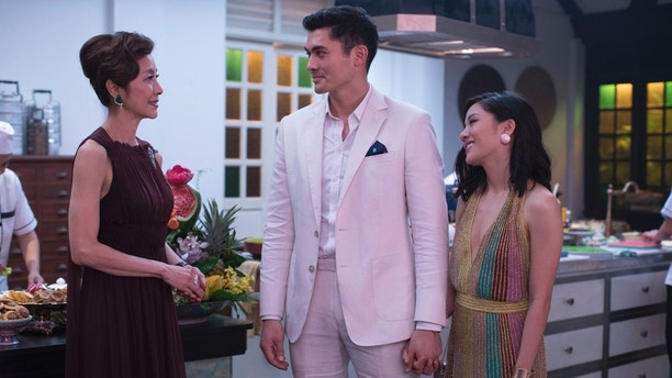 This image released by Warner Bros. Leisure displays Michelle Yeoh, from left, Henry Golding and Constance Wu in a scene from the film