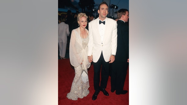 Actress Patricia Arquette and actor Nicolas Cage arrive at the 1996 Screen Actors Guild Awards. This photo appears on page 180 in Frank Trapper's RED CARPET book. (Photo by Frank Trapper/Corbis via Getty Images)