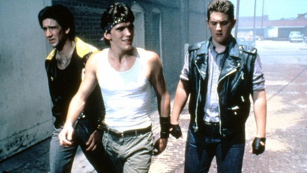 American actors Nicolas Cage, Matt Dillon and Chris Penn on the set of Rumble Fish, written, directed, and produced by Francis Ford Coppola. (Photo by Sunset Boulevard/Corbis via Getty Images)