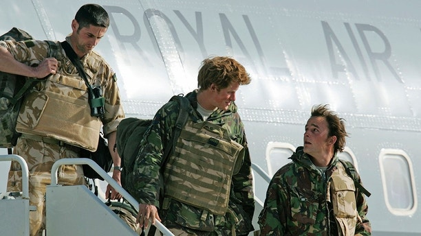 FILE - In this Saturday, March 1, 2008 file photo, Britain's Prince Harry, center, exits a military transport aircraft shortly after landing, upon his return from active duty in Afghanistan, at the Royal Air Force's Brize Norton air base in Oxfordshire, southern England. Long dismissed as a party boy, Prince Harry has transformed himself in the public eye and enjoys widespread popularity as he prepares to marry Meghan Markle on May 19, 2018. Harry has become a forceful advocate for veterans and won admiration by speaking openly about his struggle with the pain caused by the early death of his mother, Princess Diana.(AP Photo/Lefteris Pitarakis, file)