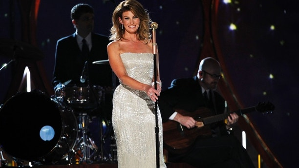 """Singer, actress and mom of three with husband of nearly two decades Tim McGraw. The """"Breathe"""" singer made a surprise performance with her hubby at the 49th ACMs and not only captivated the audience, but caught McGraws eye as well. Great fun singing with my wife last night! he tweeted. Seeing Faith walk out in that dress for the 1st time took my breath away. Hard to recover."""" The feelings mutual Tim."""