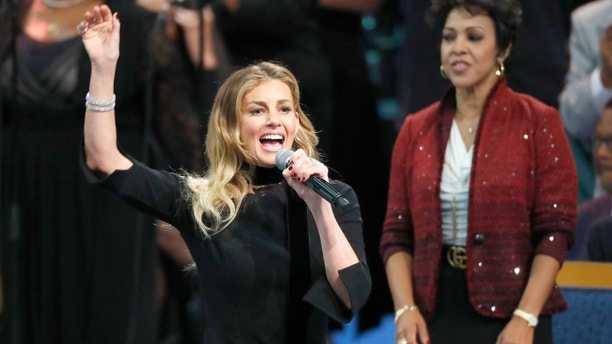 Faith Hill performs during the funeral service for Aretha Franklin at Greater Grace Temple, Friday, Aug. 31, 2018, in Detroit. Franklin died Aug. 16, 2018 of pancreatic cancer at the age of 76. (AP Photo/Paul Sancya)