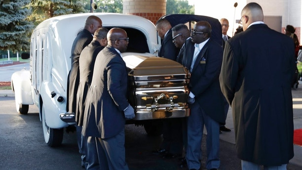 Pallbearers carry the gold casket of legendary singer Aretha Franklin after arriving at the Greater Grace Temple in Detroit, Friday, Aug. 31, 2018. Franklin died Aug. 16 of pancreatic cancer at the age of 76. (AP Photo/Tony Dejak)