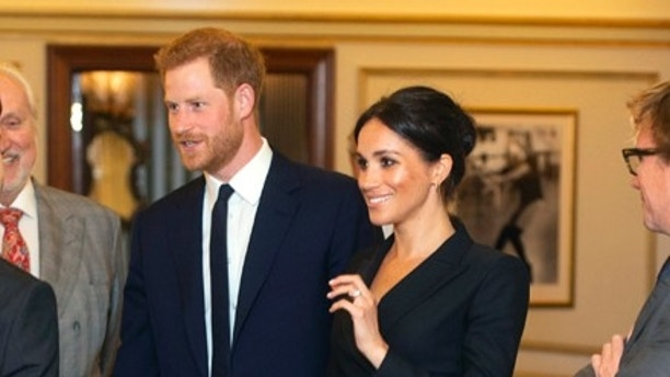 British Prince Harry and Meghan, Duchess of Sussex Victoria Palace Theater in front of a gala performance of the musical Hamilton, in support of the charity Sentebale, in London, Wednesday, August 29, 2018. The evening will raise awareness and money for Sentebales Working with HIV-infected children and adolescents in southern Africa. (Dan Charity / Pool Photo via AP)