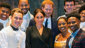 Britain's Prince Harry and Meghan, Duchess of Sussex, center, meet the cast after a gala performance of the musical Hamilton, in support of the charity Sentebale, at the Victoria Palace Theatre in London, Wednesday, Aug. 29 2018. The evening will raise awareness and funds for Sentebale's work with children and young people affected by HIV in southern Africa. (Dan Charity/Pool Photo via AP)