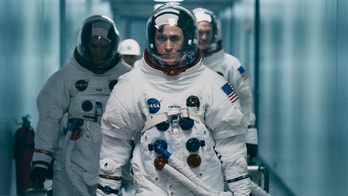 "This image released by Universal Pictures shows Ryan Gosling in a scene from ""First Man."" (Daniel McFadden/Universal Pictures via AP)"