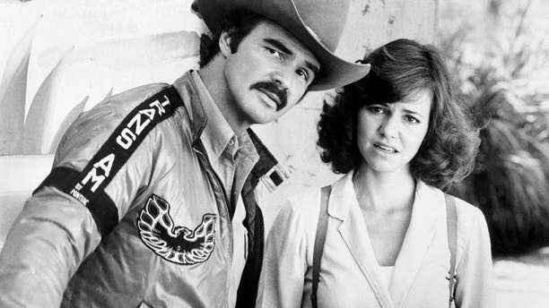 "(Original Caption) Together Again. Burt Reynolds, who plays ""The Bandit,"" and Sally Field share a scene in the new Universal Studio's release Smokey and the Bandit III, which is to open in New York. The new movie is a sequel to Smokey and the Bandit in which the two also starred."